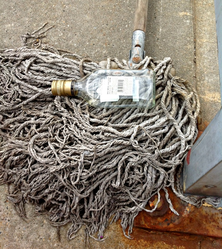 Yo-ho and a bottle of rum.  And a mop.  This was lying on the platform of the train station.  I think it looks quite artsy, don't you? I'm calling in Rum on a Mop.
