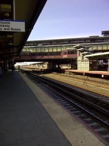 Manhattan, thatta way.  Waiting at the train station in Queens...