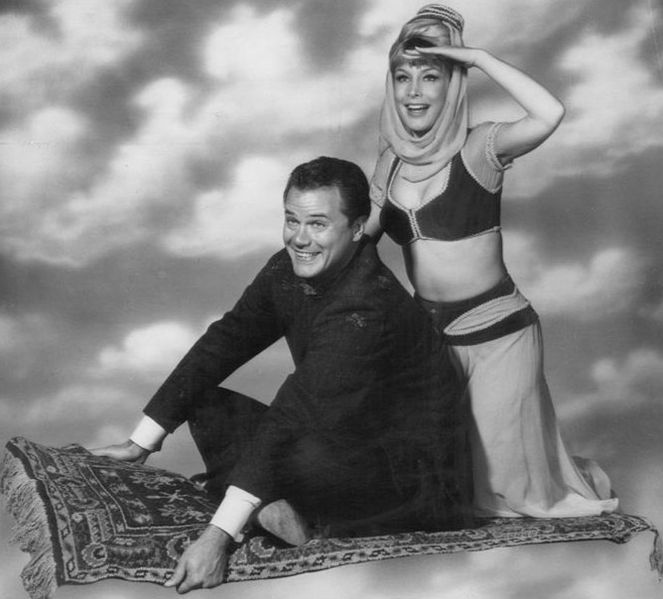 The only way Jeannie could bare or navel-gaze was if she popped in her bottle.  But she could gaze at Tony's and he could navel gaze all he wanted.  Figures.