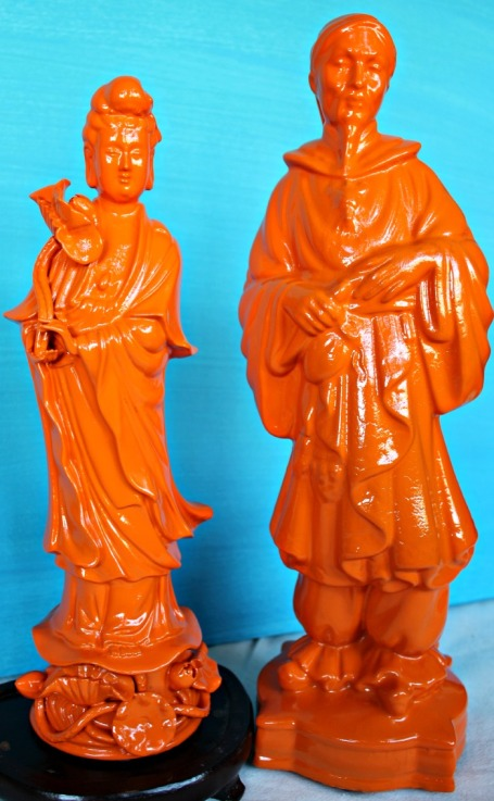 An oriental dude and lady purchased from two different places.  One was all white, the other an yucky beige, black and red. Now they've found each other and they're bright, glossy orange. Zen.