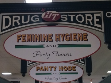 Actual sign in a grocery store. Feminine hygiene, party favors...what's the diff?